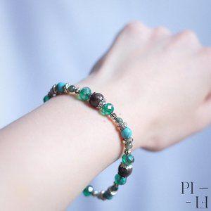 2/50$ bracelet with natural obsidian gemstones